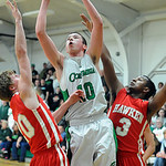 Columbia's David Delhunty puts up a shot between Hawken's Ian Bell, left,and Warren Starks. STEVE MANHEIM/CHRONICLE