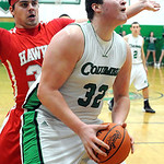 Columbia's Brandon Heidecker goes to the hoop past Hawken's Josh Walters. STEVE MANHEIM/CHRONICLE