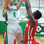 Columbia's Jay Banyasz hits a shot over Hawken's Warren Starks. STEVE MANHEIM/CHRONICLE