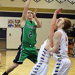 Columbia's Brandon Severo shoots over Vermilion's Ross Lewis, center, and Forrest Boyd. STEVE MANHEIM/CHRONICLE