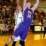 Avon's Zach Torbert shoots past Elyria Catholic's Ceeven Shelton. LINDA MURPHY/CHRONICLE