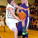 Elyria Catholic's Jacob Kuchta tries to shoot past Avon's Dan Durrin. LINDA MURPHY/CHRONICLE