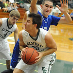 Elyria Catholic's Jeremy Holley sets to put up a shot over Bay's Rex Sunahara. STEVE MANHEIM/CHRONICLE