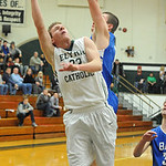 Elyria Catholic's Jacob Kuchta is fouled by Bay's John Koz while putting up shot. STEVE MANHEIM/CHRONICLE