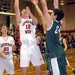 Lutheran West's Andrew O'Hara shoots past Elyria Catholic's James Tirbaso. LINDA MURPHY/CHRONICLE