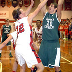 Elyria Catholic's Jeremy Holley shoots over Lutheran West's Andrew O'Hara. LINDA MURPHY/CHRONICLE