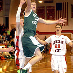 Elyria Catholic's Jacob Kuchta gets by Lutheran West's Greg Kunse. LINDA MURPHY/CHRONICLE