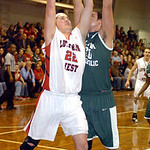 Lutheran West's Max Quinn shoots past Elyria Catholic's Jeremy Holley. LINDA MURPHY/CHRONICLE