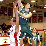 Elyria Catholic's James Tirbaso goes up for a basket against Lutheran West's Greg Kunse during Tuesday's Division III sectional opener at Lutheran West. LINDA MURPHY/CHRONICLE