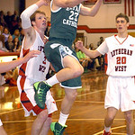 Elyria Catholic's Jacob Kuchta goes up for a basket against Lutheran West's Greg Kunse. LINDA MURPHY/CHRONICLE