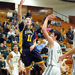 North Ridgeville's Chad Kisel puts up A shot over Elyria Catholic's James Tirbaso. STEVE MANHEIM/CHRONICLE