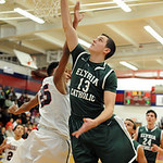 Elyria Catholic's Drew Caplan puts up a shot. STEVE MANHEIM/CHRONICLE