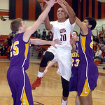 Elyria's Isaiah Walton shoots against Lakewood's Jacob Schmidt, left, and Logan Swift. LINDA MURPHY/CHRONICLE