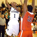 Lorain's Eddie Williamson shoots past Elyria's Chris Jamison. LINDA MURPHY/CHRONICLE