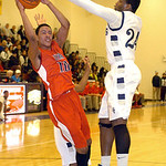 Lorain's Rashod Berry blocks Elyria's Isaiah Walton as he tries to shoot. LINDA MURPHY/CHRONICLE
