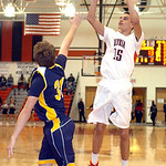Elyria Jarred Schultz shoots past North Ridgeville's Tyler Arnold. LINDA MUPRHY/CHRONICLE