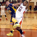 Elyria's Trenell Oliver drives shoot North Ridgeville's Nathan Colbert. LINDA MURPHY/CHRONICLE