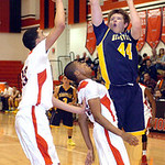 North Ridgeville's Nathan Colbert shoots past Elyria's Jarred Schultz, left, and Trenell Oliver. LINDA MURPHY/CHRONICLE