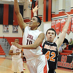 Elyria's Isaiah Walton goes to the basket past Normandy's Donny Campbell. STEVE MANHEIM/CHRONICLE