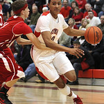 ANNA NORRIS/CHRONICLE<br /> Elyria&#039;s Isaiah Walton drives to the basket around Parma&#039;s Sean Ivancic in the second quarter Friday night at Elyria High School.