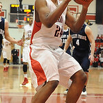 Elyria's AJ Johnson takes a shot. STEVE MANHEIM/CHRONICLE