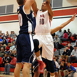 Elyria's Isaiah Walton goes up over Valley Forge's Bradley Brodek. STEVE MANHEIM/CHRONICLE