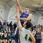 Keystone's Brandon Kuhl shoots over Columbia's Jay Banyasz. STEVE MANHEIM/CHRONICLE