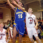 Clearview's Jason Young goes up for a shot against Lutheran West's Joe Peters. LINDA MURPHY/CHRONICLE