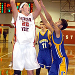 Lutheran West's Max Quinn tries to shoot over Clearview's Jason Young. LINDA MURPHY/CHRONICLE