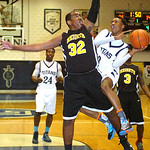 Lorain's Sherman Saunders tries to shoot aroudn Cleveland Heights' Romeo Moore. LINDA MURPHY/CHRONICLE