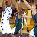 Lorain's Gerald Howard tries to shoot past Westlake's Cameron Brown and Gavin Skelly. LINDA MURPHY/CHRONICLE