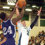 Lorain's Rashod Berry fights Westlake's Anthony Trujillo for the rebound. LINDA MURPHY/CHRONICLE