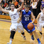 Midview's Jacob Wells drives past Vermilion's Ross Lewis. STEVE MANHEIM/CHRONICLE