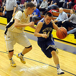 Midview's Grant Overy drives past North Ridgeville's Dennis Millgard. STEVE MANHEIM/CHRONICLE