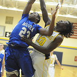 Midview's Daimone Mahone and North Ridgeville's Demario McCall battle for a rebound. STEVE MANHEIM/CHRONICLE