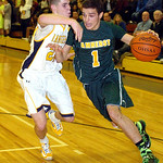 Amherst's Antonio Serrano drives around North Ridgeville's Dennis Millgard. LINDA MURPHY/CHRONICLE