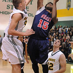 Amherst's Danny Fortney blocks a shot by Oberlin's Devonte Hougland. STEVE MANHEIM/CHRONICLE