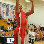 Isaiah Walton drives past Oberlin's Malcolm Allen. STEVE MANHEIM/CHRONICLE