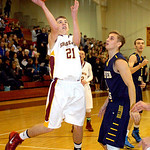 Avon Lake's Jason Hessel shoots past Olmsted Falls' Sam Lombardo. LINDA MURPHY/CHRONICLE