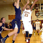 Avon Lake's Christian Jones shoots past Olmsted Falls' Kevin Meehan. LINDA MURPHY/CHRONICLE