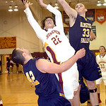 Avon Lake's Luke Harris tries to shoot past Olmsted Falls' Ryan Sosic and Evan Manley. LINDA MURPHY/CHRONICLE