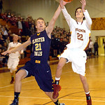 Avon Lake's Luke Harris tries to shoot past Olmsted Falls' Kevin Meehan. LINDA MURPHY/CHRONICLE