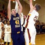 Olmsted Falls' Ryan Sosic tries to shoot past Avon Lake's Jace Russell, behind, and Jason Hessel. LINDA MURPHY/CHRONICLE