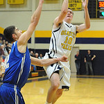 Olmsted Falls' Patrick Hynes puts up a shot over Midview's Jack Duffner. STEVE MANHEIM/CHRONICLE