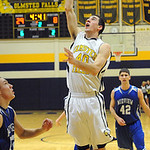Olmsted Falls' Adam Asadorian puts in shot over Midview's Logan Bolin. STEVE MANHEIM/CHRONICLE