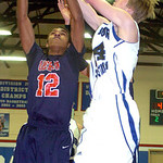 Oberlin's Charlesa Lewis and Open Door's Cory Kushinski fight for the rebound. LINDA MURPHY/CHRONICLE