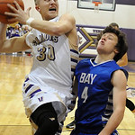 Vermilion's Cameron Kuhn goes to the hoop over Bay Danny Heideloff. STEVE MANHEIM/CHRONICLE