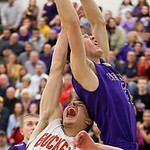 Vermilion's Seth Konrad grabs a rebound against Buckeye's Tyler Hagmeier during the fourth quarter of the Westlake district semi-final game. (RON SCHWANE / CT)