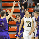 Norwalk's Breck Turner (33) reacts as Vermilion's Seth Konrad (21) celebrates his game-tying three-point basket with Aaron Dawson (3) and Forrest Boyd at the end of regulation. DAVID RICHARD …