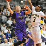 Cameron Kuhn, left, of Vermilion drives past Norwalk's Ben Haraway in the first quarter. DAVID RICHARD / CHRONICLE